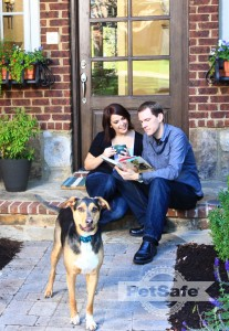 Sarah, with husband, Doug, and happy hound, Tyson.